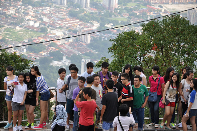 Image: Chinese tourists in Georgetown, Malaysia ©Shankar S, licensed by Creative Commons via flickr