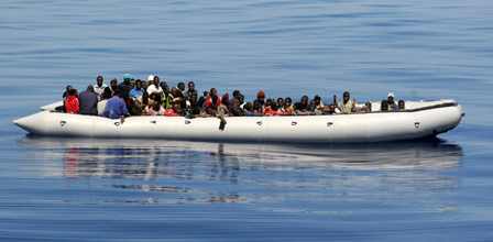 87 migrants crammed into an inflatable craft in the Mediterranean Sea, near the island of Lampedusa. Image credit: Zodiac © Noborder Network. Licensed under creative commons via flickr.