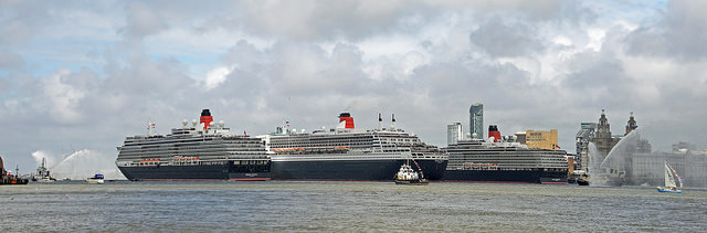 The Cunard 'Three Queens' (The Queen Mary 2, Queen Elizabeth and Queen Victoria) in Liverpool. Image: The Three Queens by Andrew, licensed under Creative Commons via flickr