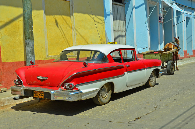 Some typical modes of travel on the streets of Trinidad, Cuba. Many in the US, including some businesses, are calling for the lifting of travel and trade restrictions between the US and Cuba. Image credit: Views from the Street in Cuba, Bud Ellison licensed by Creative Commons via flickr.