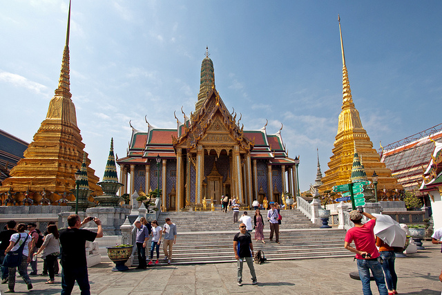 The Grand Palace, Bangkok (pictured here) is a popular tourist destination but tourist arrivals in Thailand have dropped 17 per cent in the weeks following 17th August bomb attack. Image: Grand Palace by Andrea Schaffer licensed under creative commons via flickr.